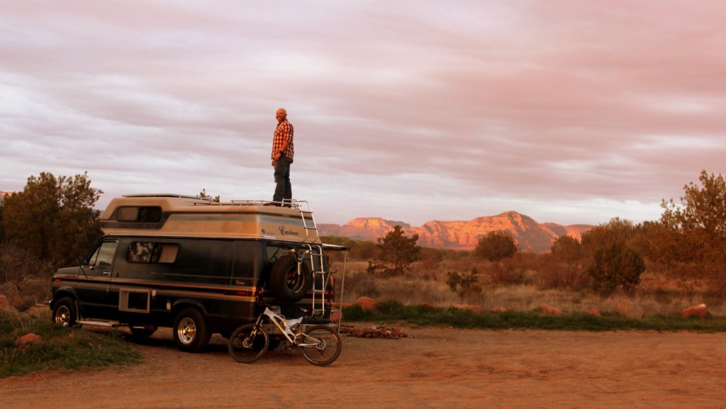 John stands on his van to get a view of the land